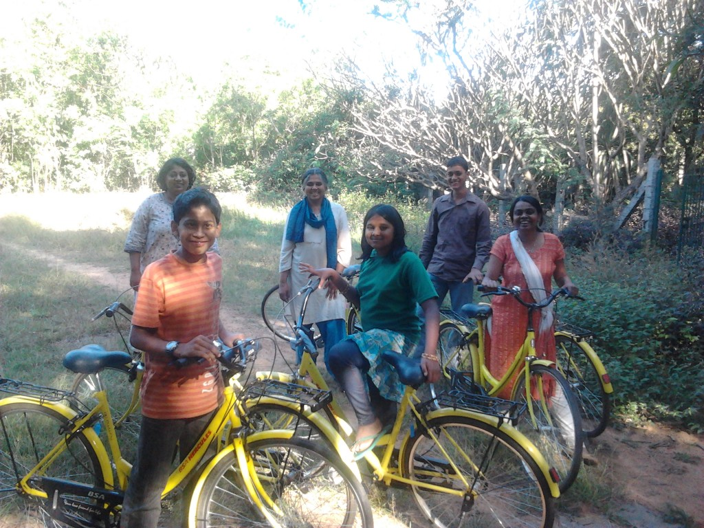 Malika Virdi with a bunch of happy kids on cycles